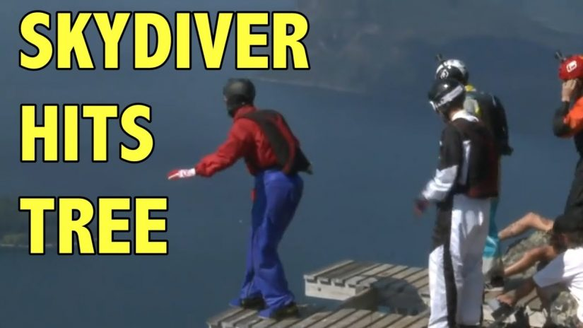 Wing Suit man Parachute fails into tree